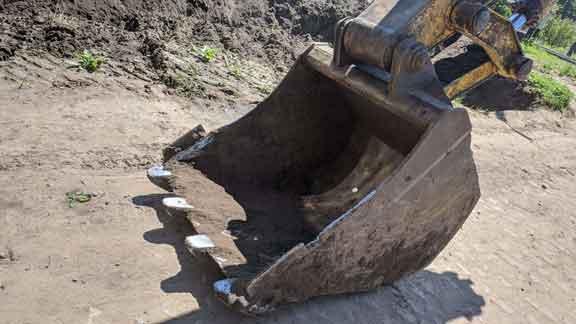 Загрузка земли, камней, воды, других отходов, что это?